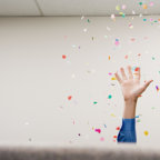Businessman throwing confetti in the air
